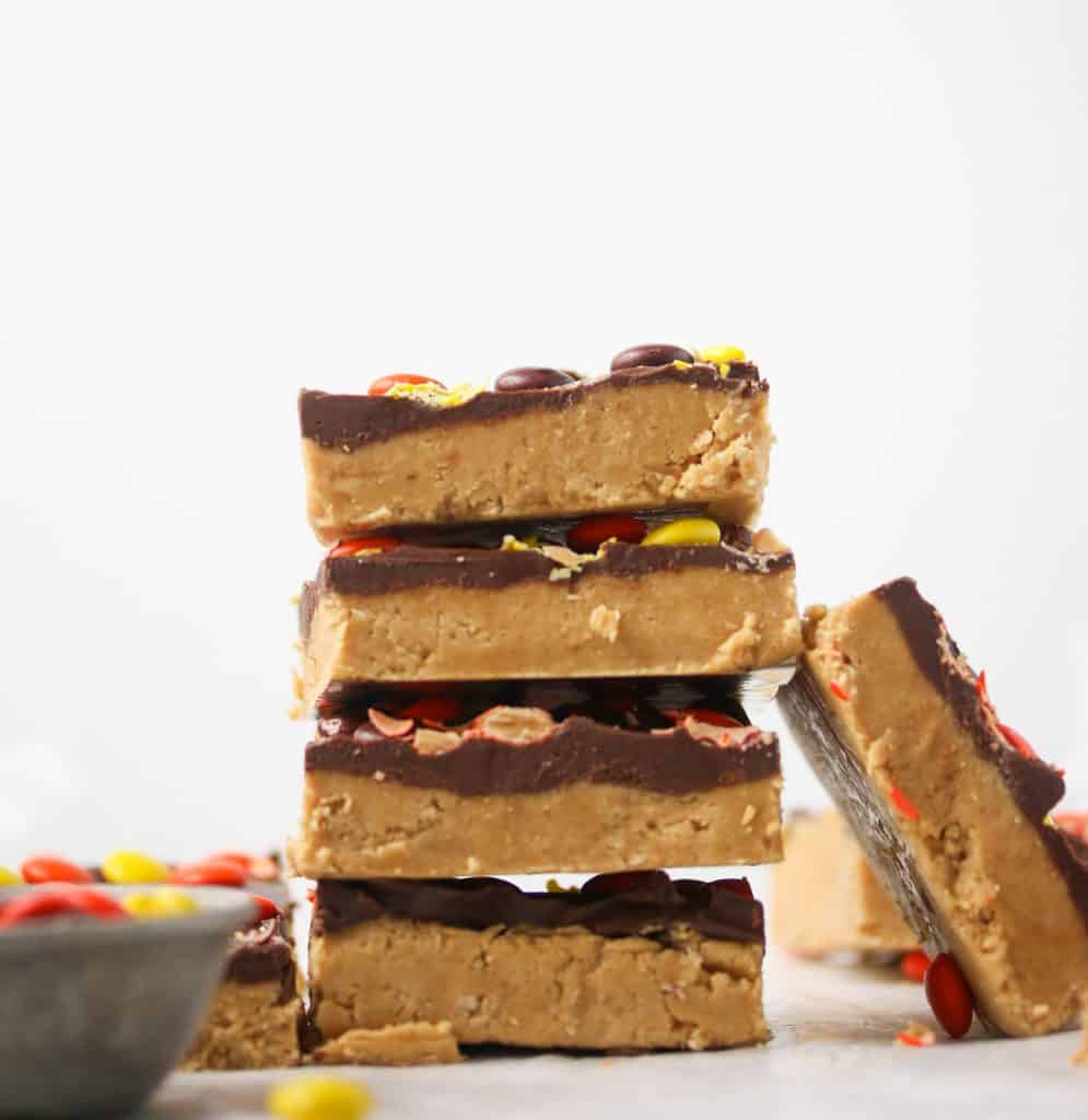 a stack of no bake peanut butter bars