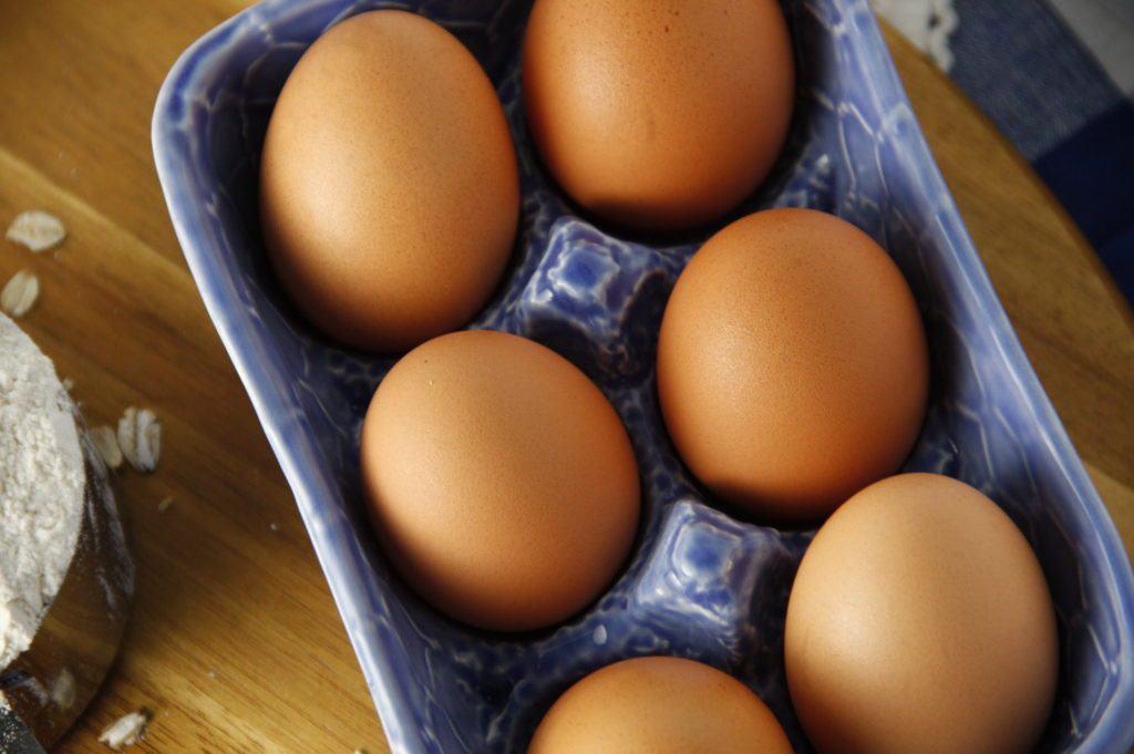 6 eggs in a blue ceramic egg dish