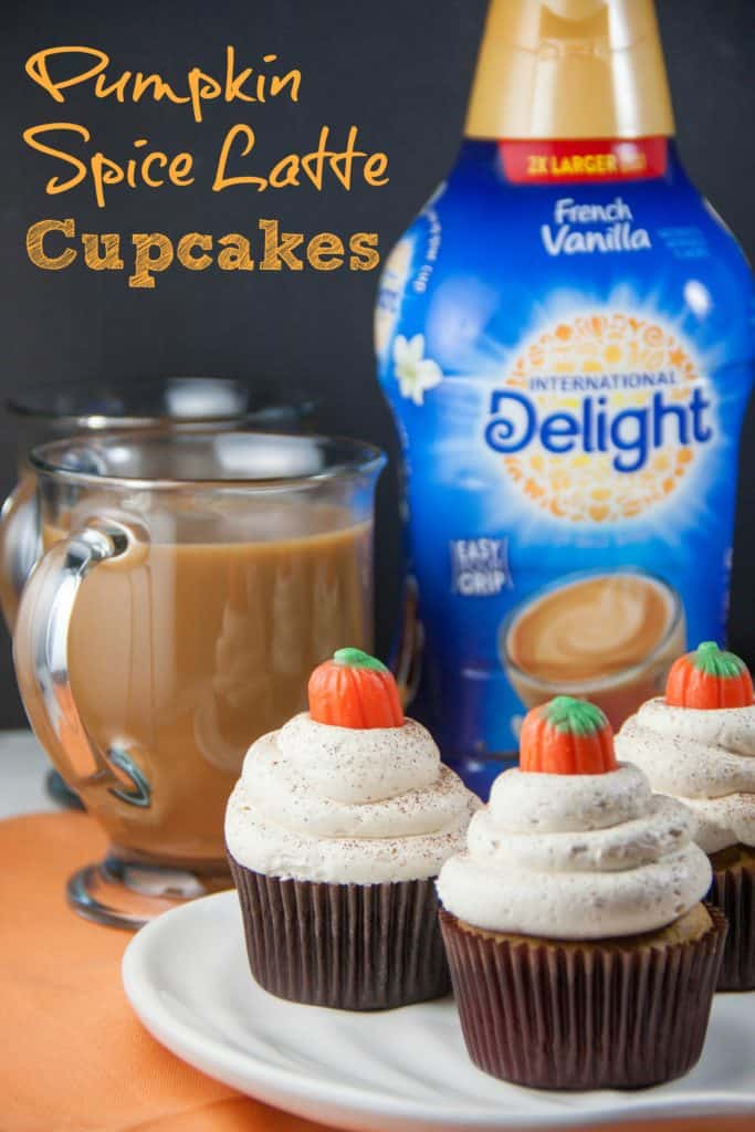 pumpkin spice latte cupcakes on a plate with coffee and bottle of creamer