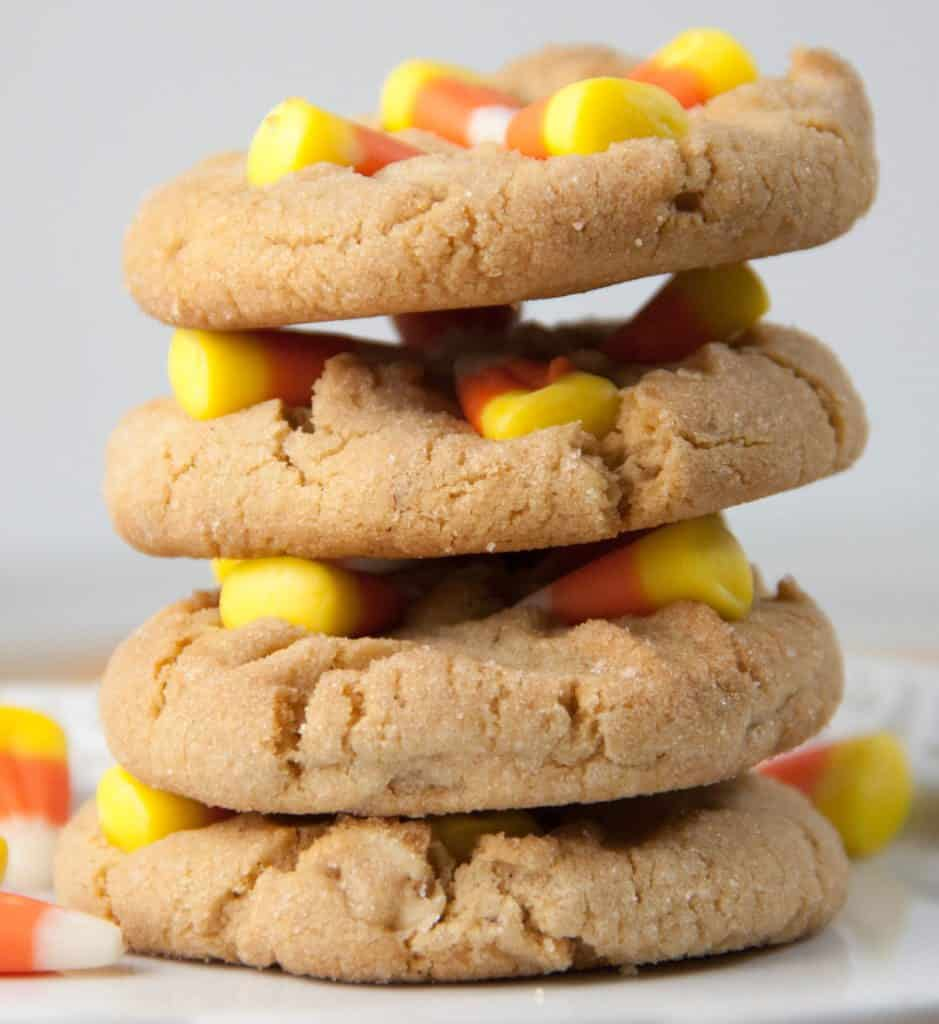 Four Candy Corn Peanut Butter Cookies stacked on top of each other