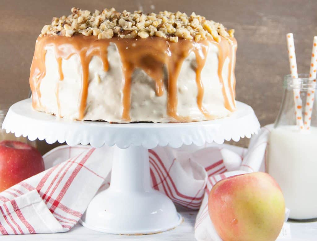 caramel apple cake on a white cake stand