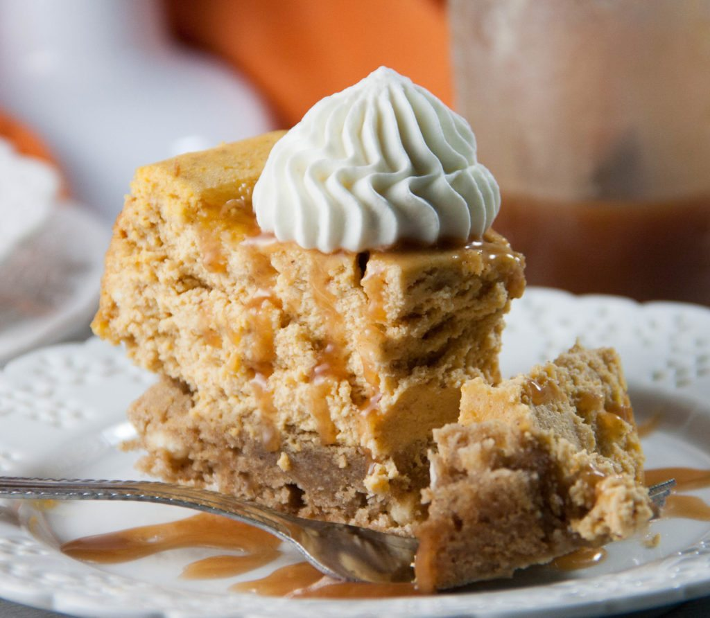 pumpkin blondie cheesecake slice with a fork