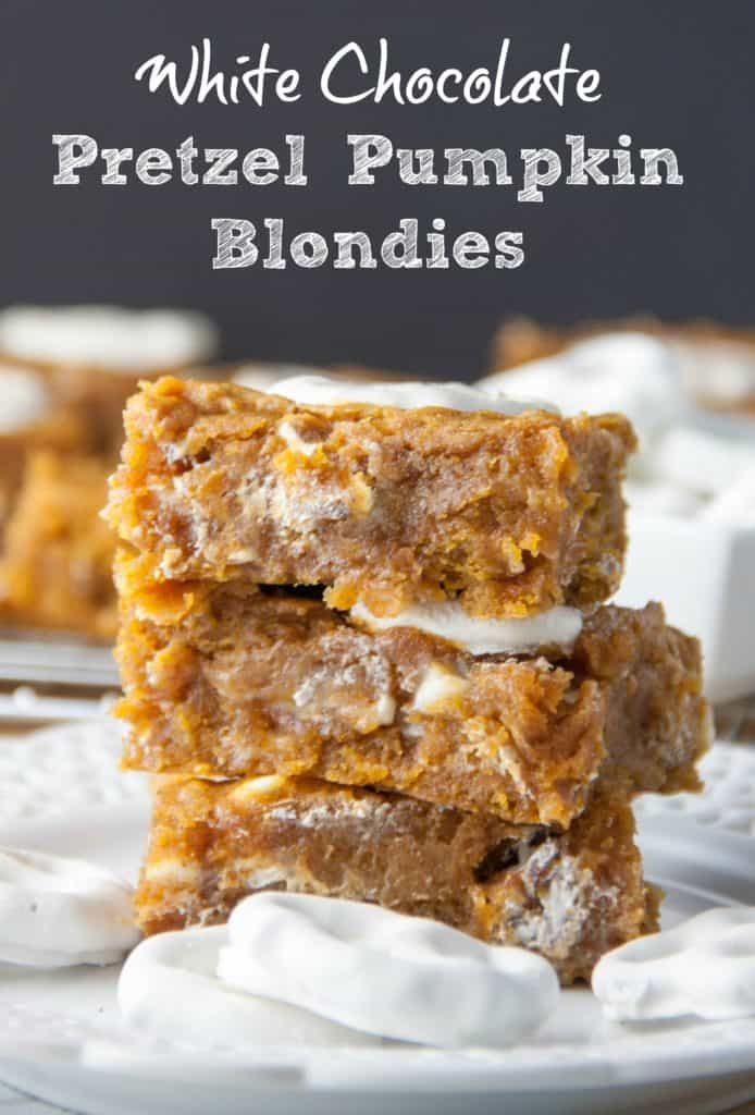 three pumpkin blondies stacked on a plate