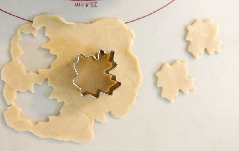 Pie dough cut out with leaf cookie cutter