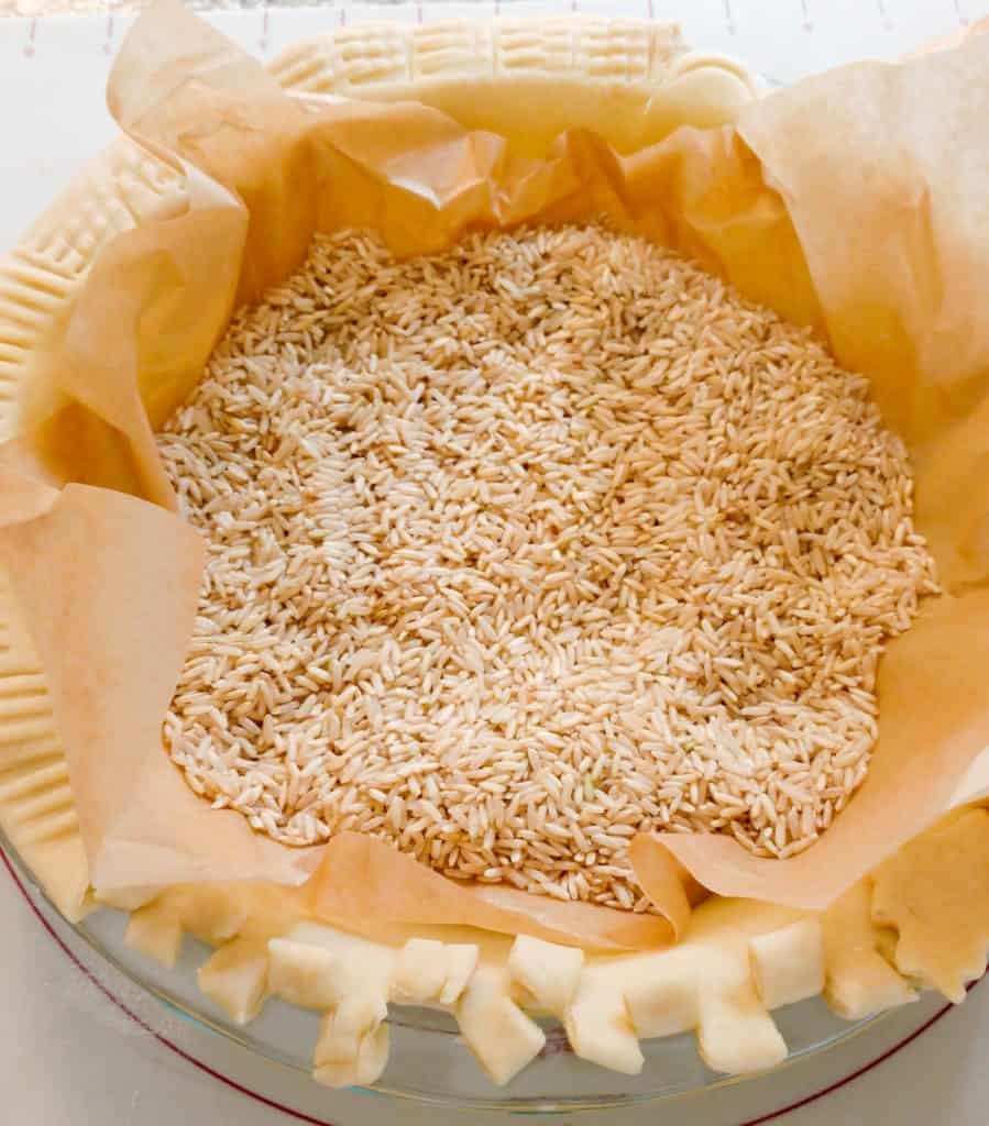 pie crust lined filled with uncooked rice
