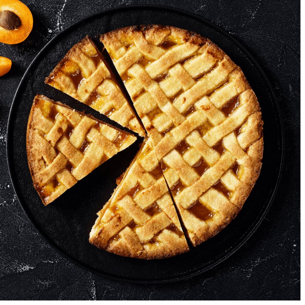 apple pie with three slices cut