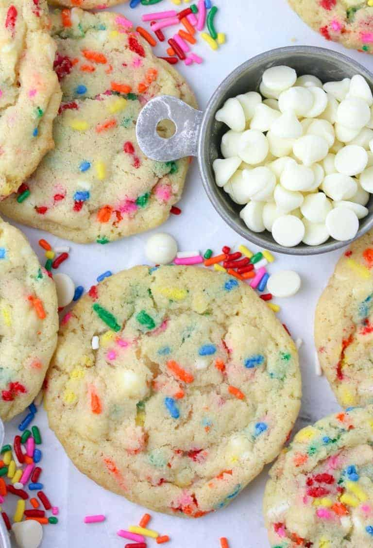 white chocolate funfetti cookies and a dish of white chocolate chips