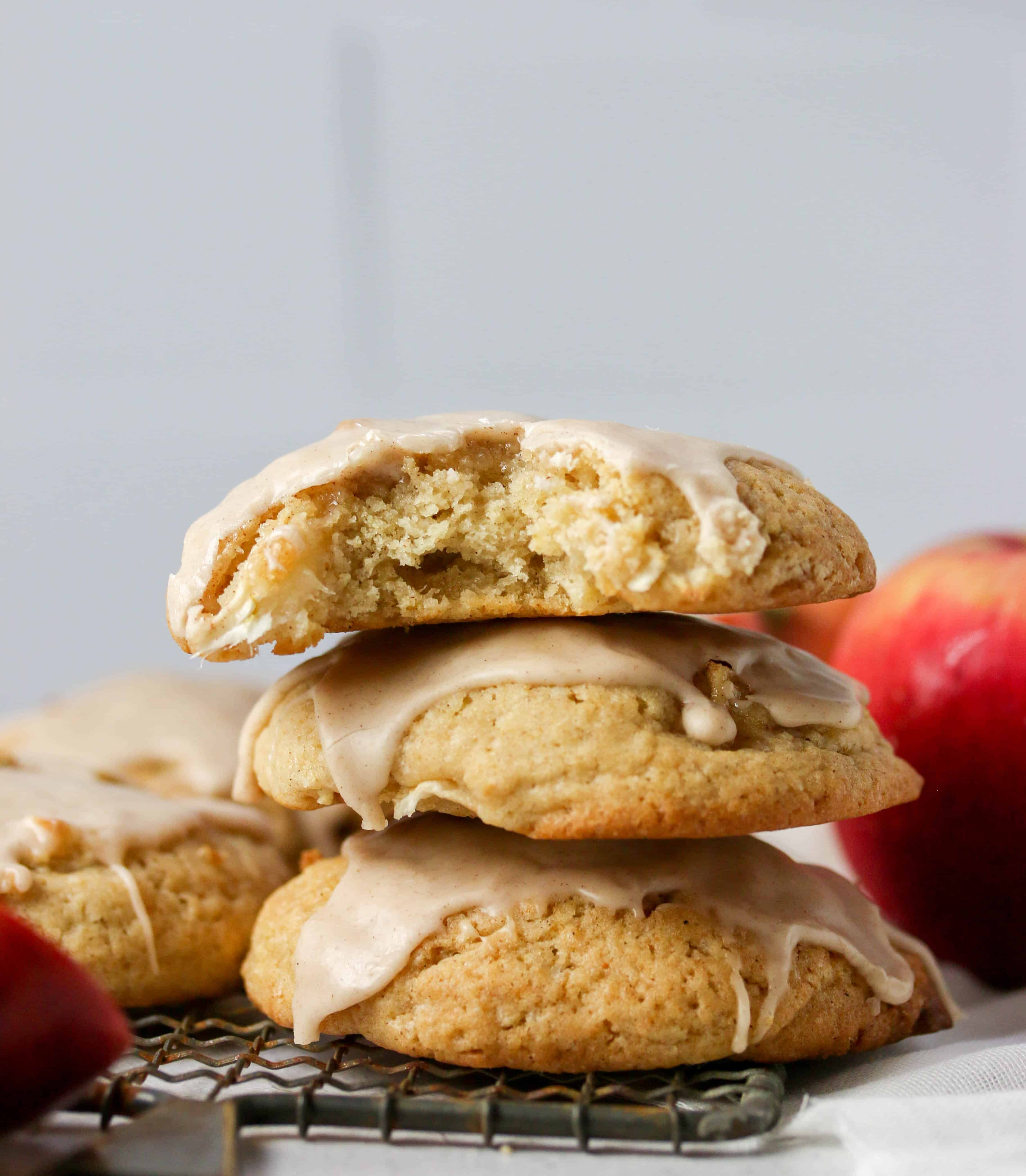 stack of apple cider cookies with a bite taken out of the top one