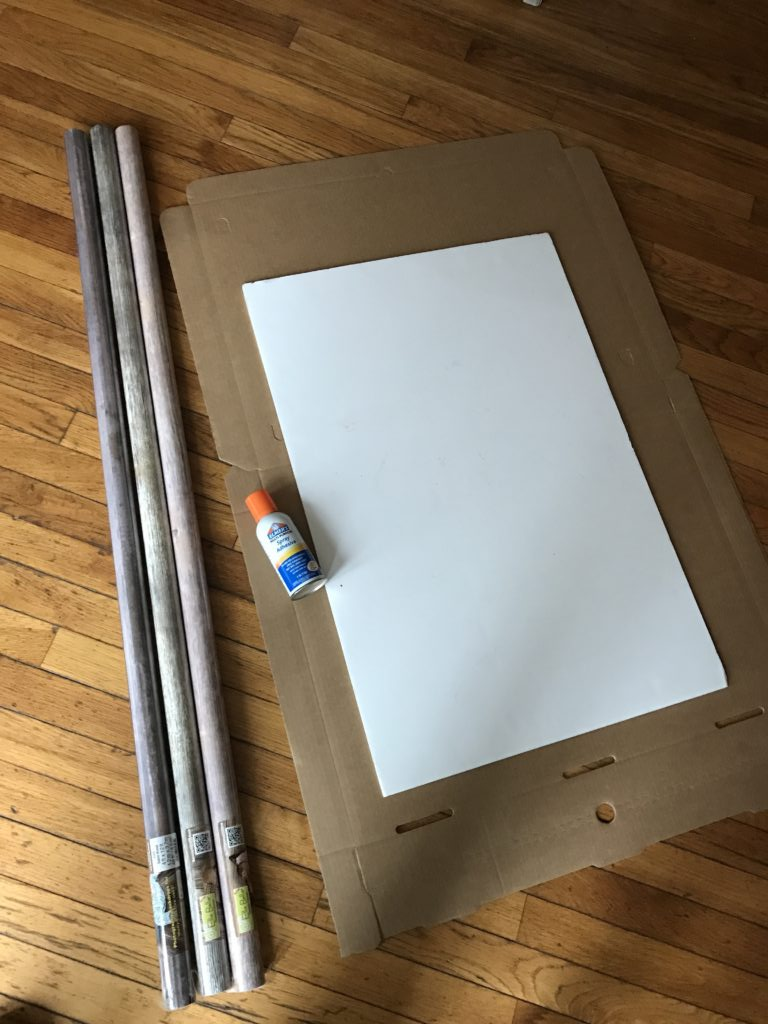 cardboard, spray adhesive, and rolls of wood photography paper