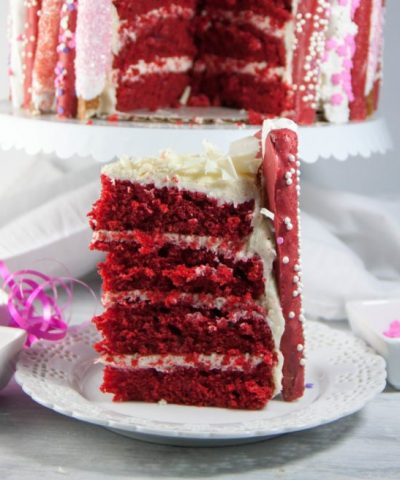 Perfect for Valentine's Day! Red velvet layer cake with white chocolate cream cheese frosting! Decorated with chocolate covered pretzel rods!
