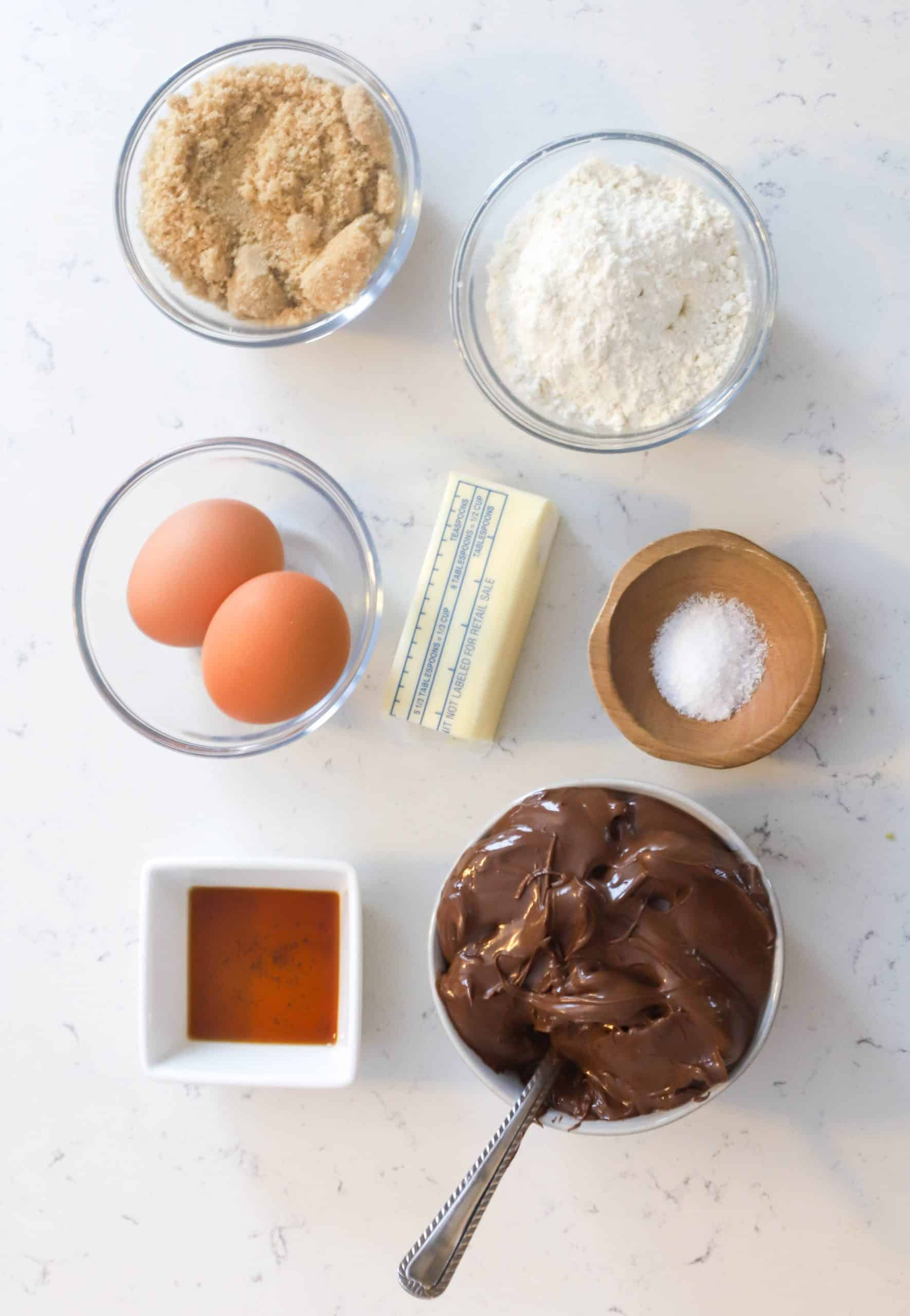 ingredients prepped in small bowls for nutella brownie recipe