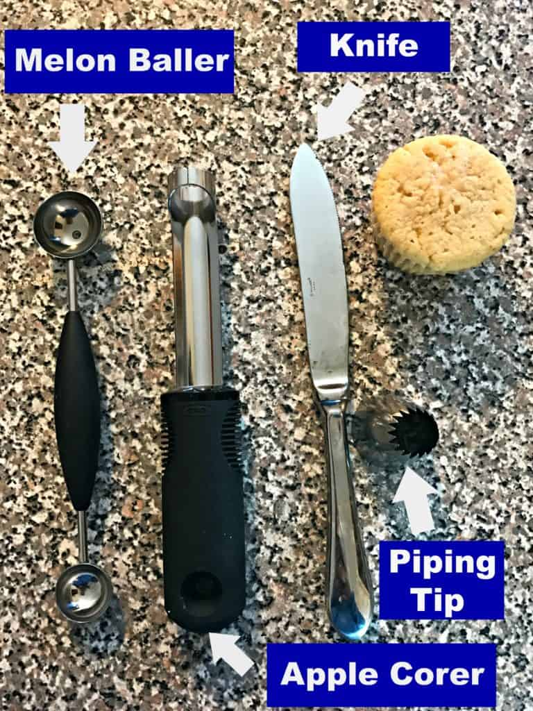 melon baller, apple corer, knife, piping tip, and a cupcake