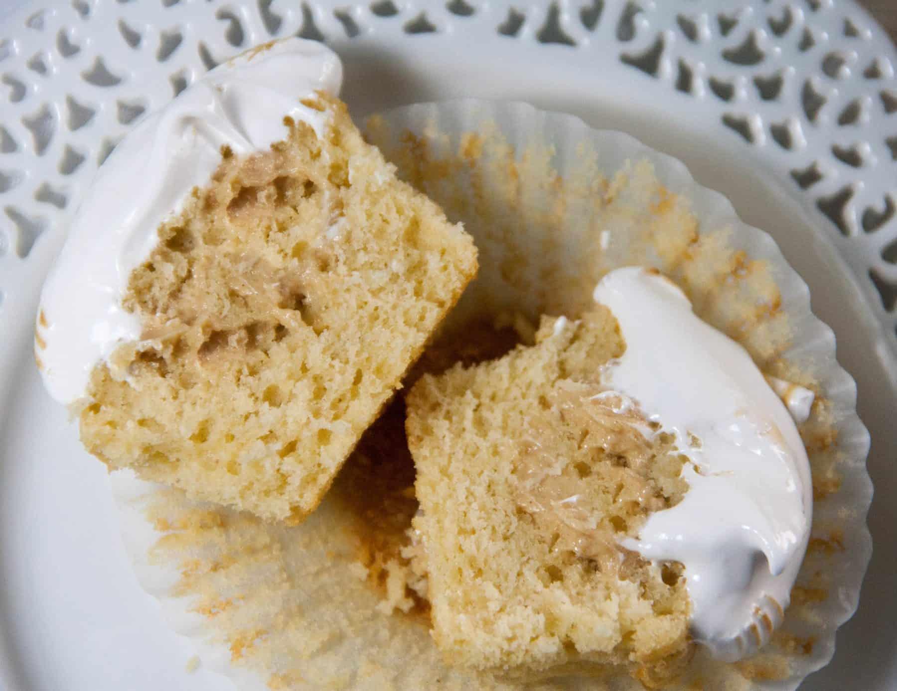 cupcake cut in half on a plate