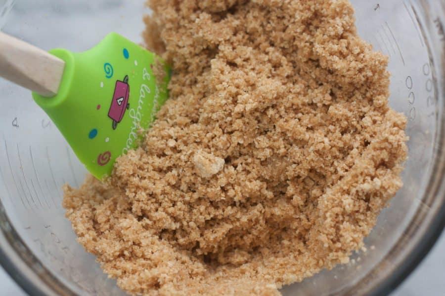 bowl of graham cracker crumbs and spatula