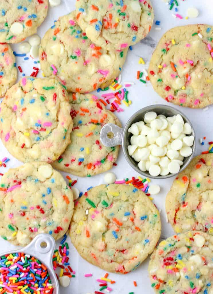 a bunch of white chocolate funfetti cookies