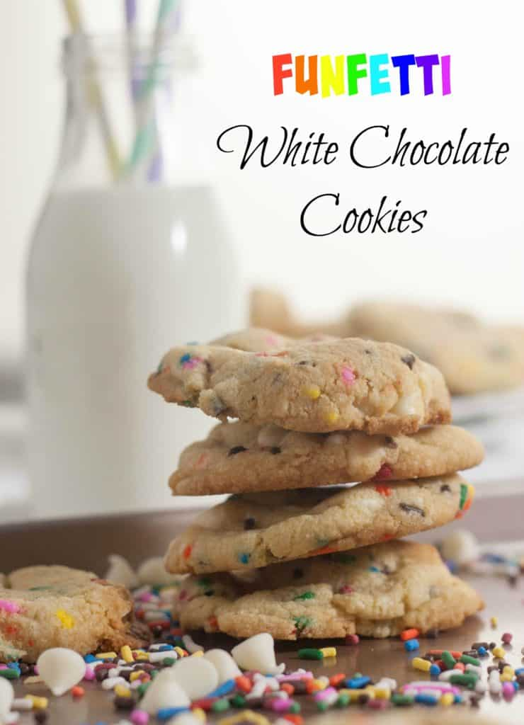 Funfetti White Chocolate Chip Cookies Stacked On Each other with milk in the background