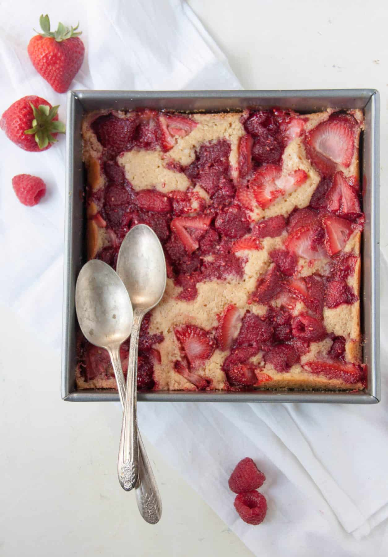 strawberry raspberry cobbler with two spoons