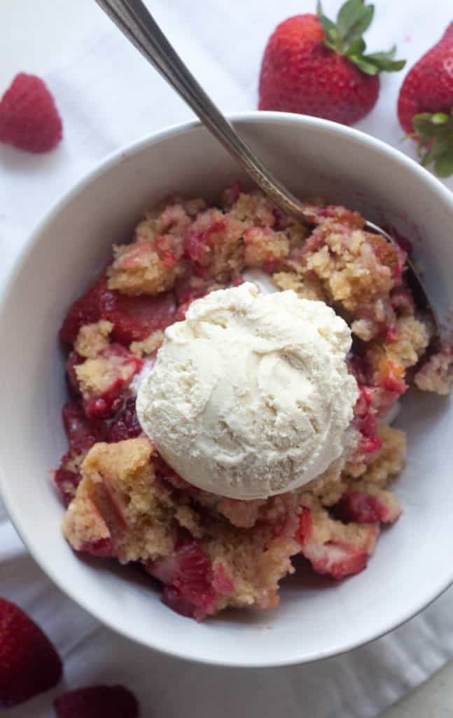 a bowl of Easy mixed berry cobbler with icecream