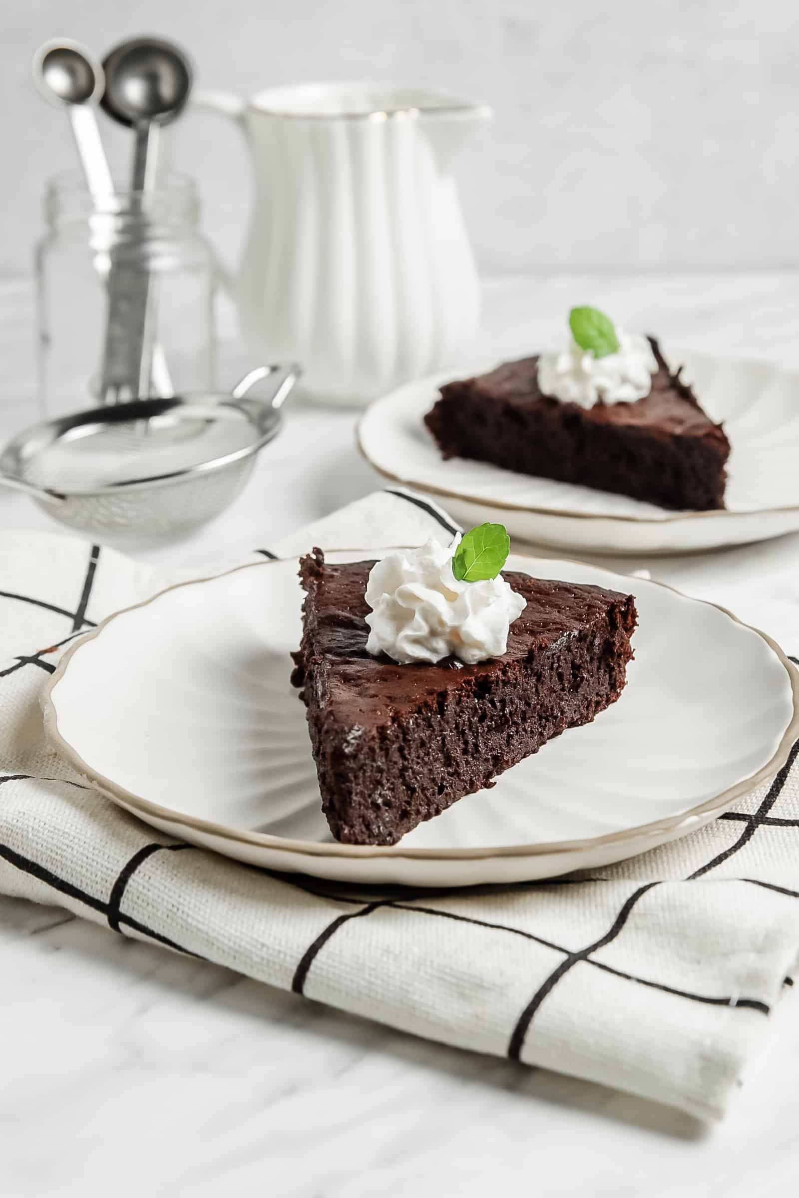 two slices of flourless chocolate cake on a plates