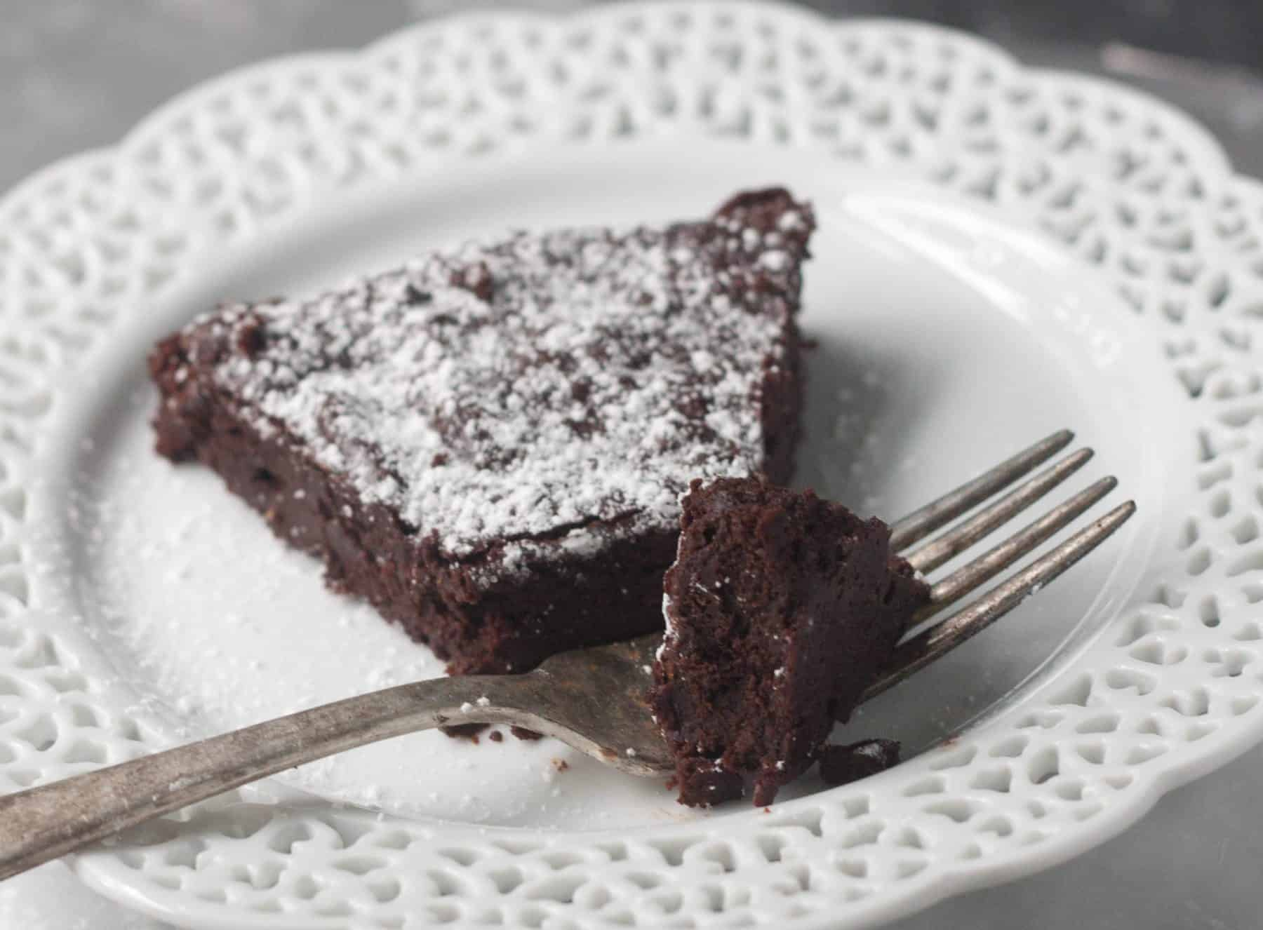 slice of flourless chocolate cake with a fork