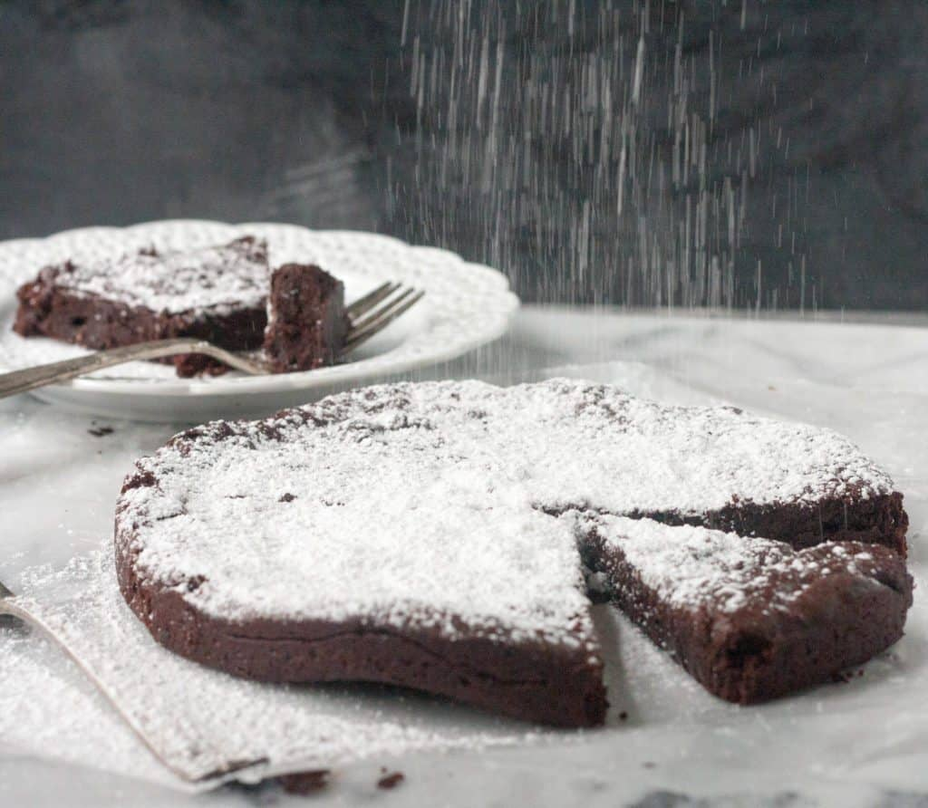 Chocolate espresso cake and a slice on a plate