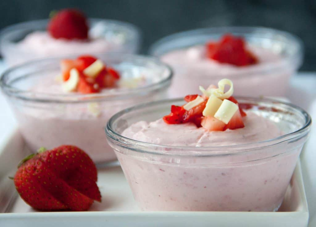 Four dishes of strawberry mousse