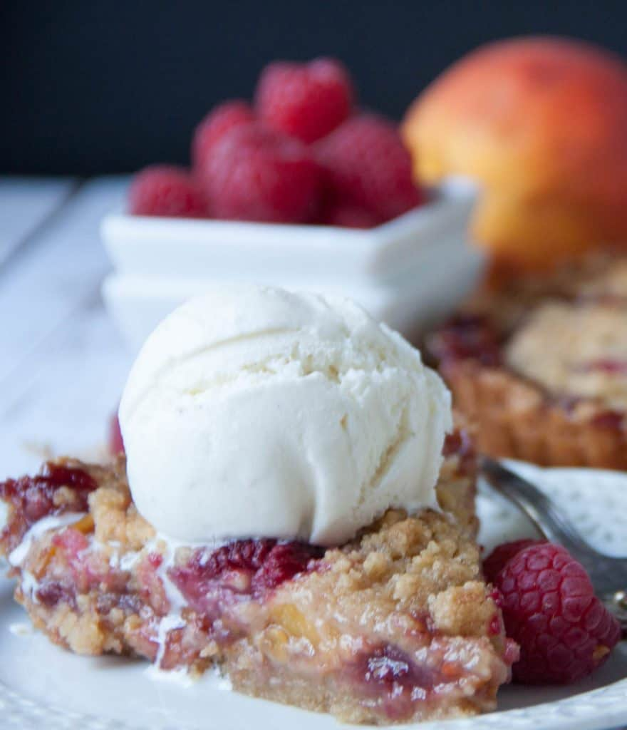 slice of peach tart topped with icecream