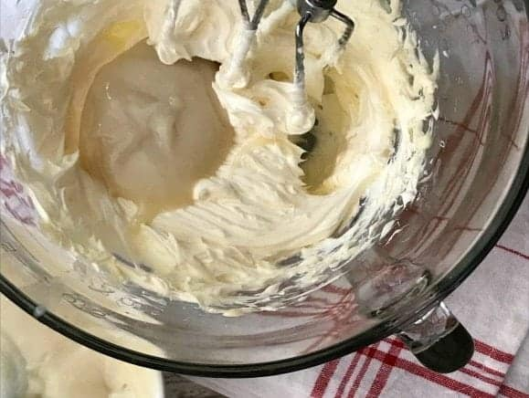 Hand Mixer creaming butter and flour paste in glass bowl
