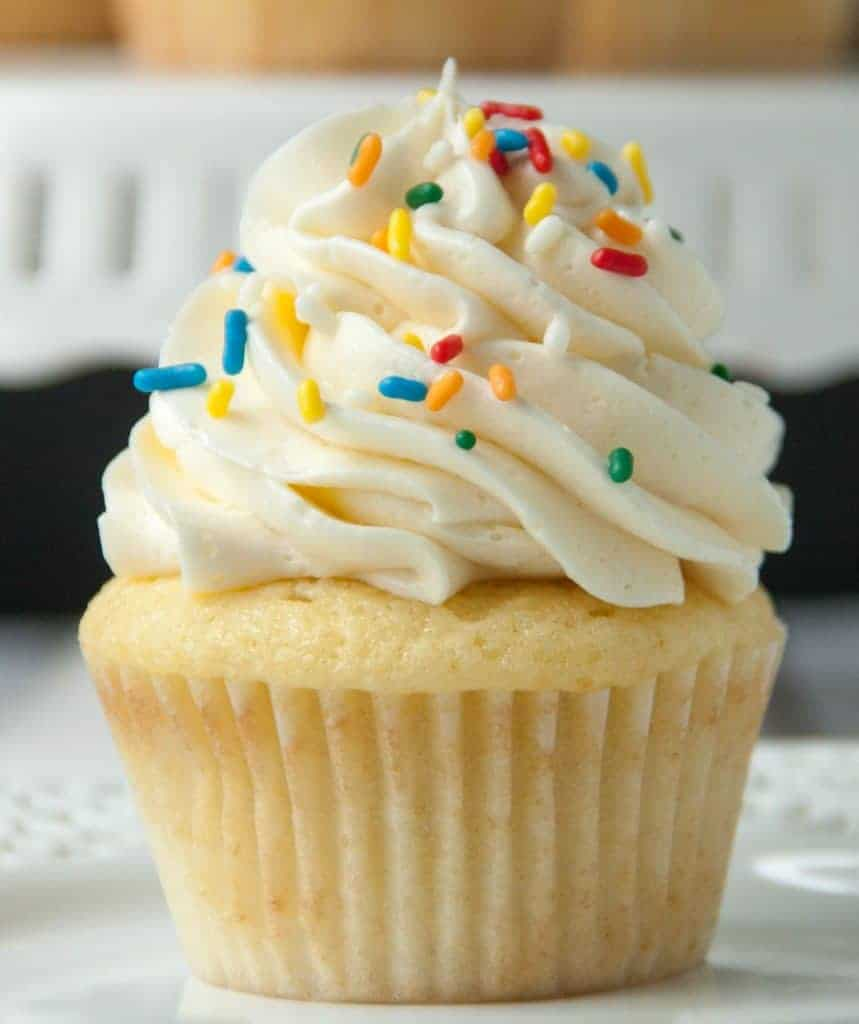 vanilla cupcake with vanilla buttercream frosting and sprinkles