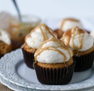 three pumpkin cupcakes on a plate