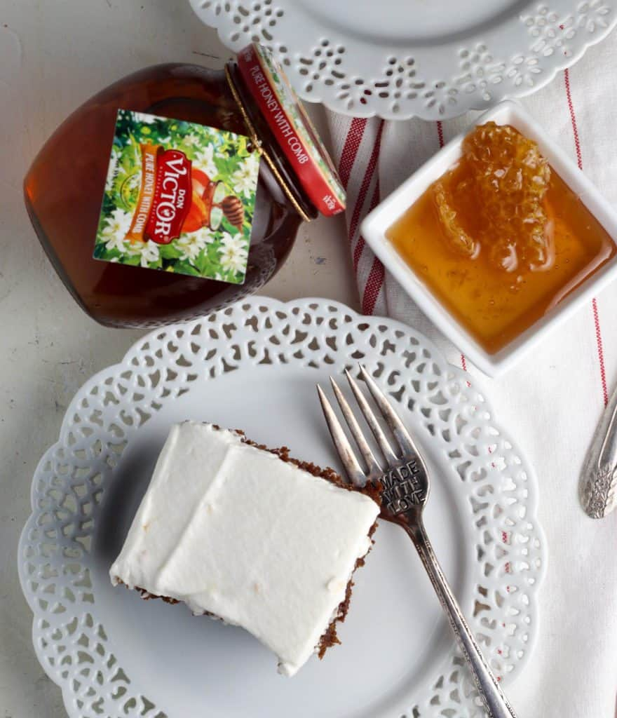 Gingerbread Poke Cakes slice with a jar of honey