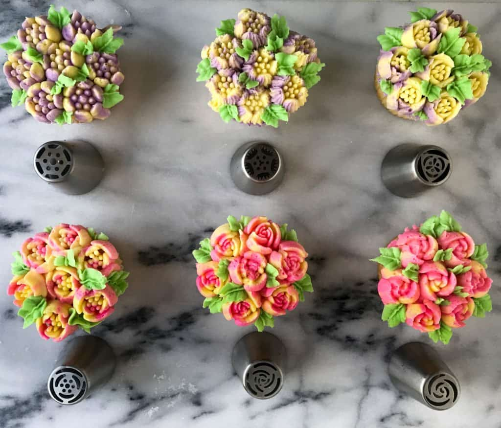 6 cupcakes decorated with russian flower tips