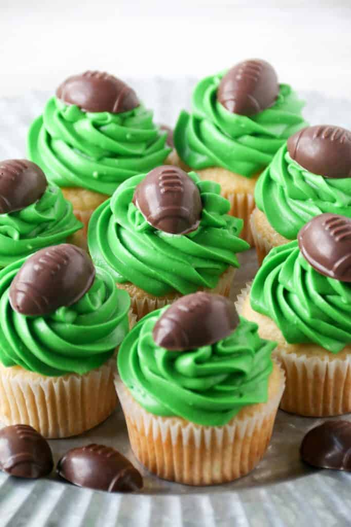 green frosted cupcakes with a chocolate football topper