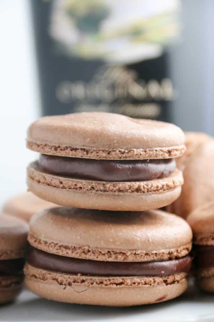 two baileys macarons stacked on top of each other