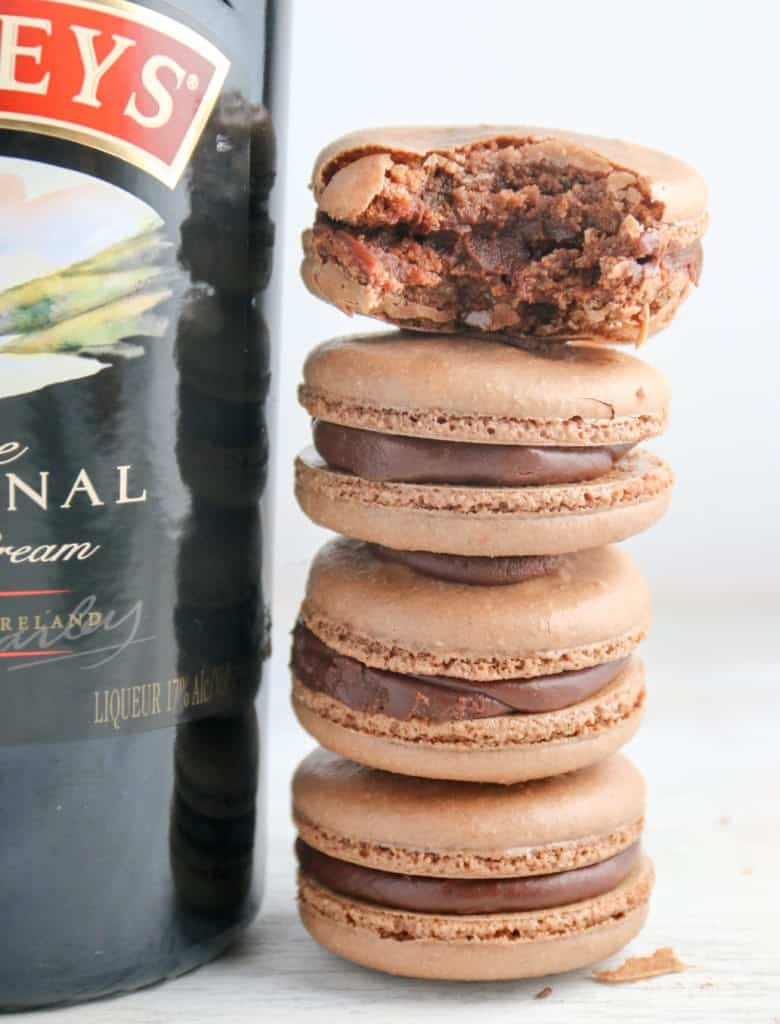 baileys macarons stacked next to a Bailey's bottle