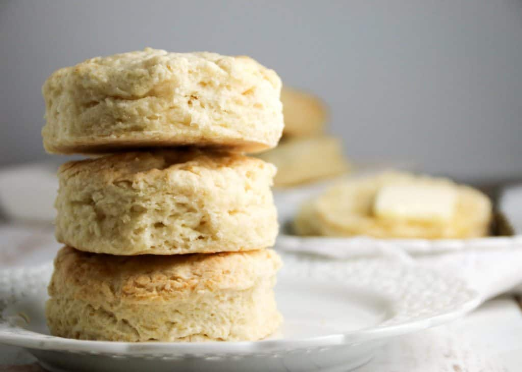 three easy buttermilk biscuits stacked on a plate