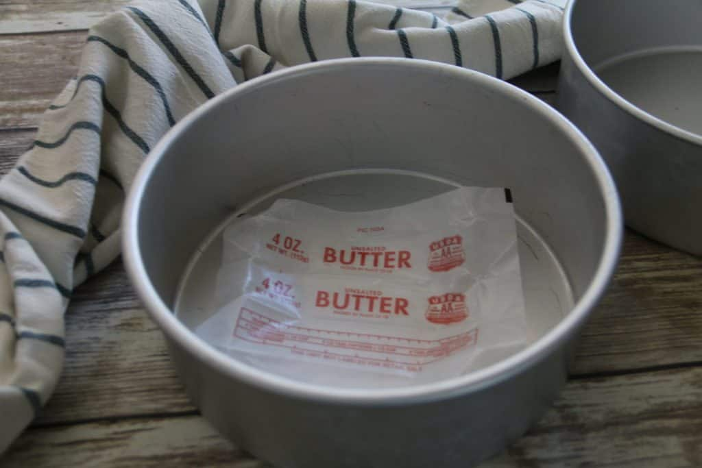 cake pan greased with butter wrapper