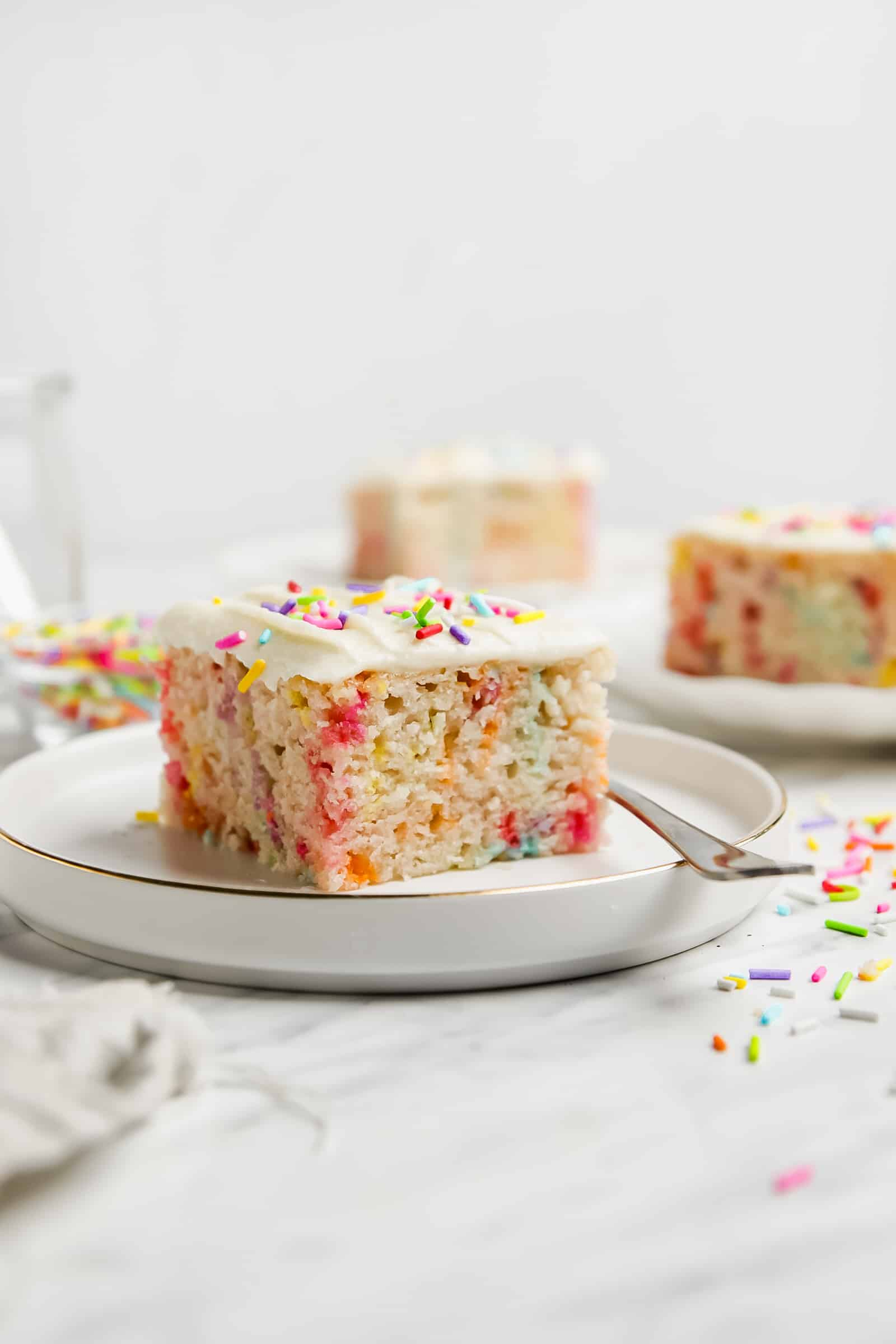 funfetti sheet cake slice on a plate