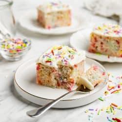 slice of funfetti sheet cake on a plate