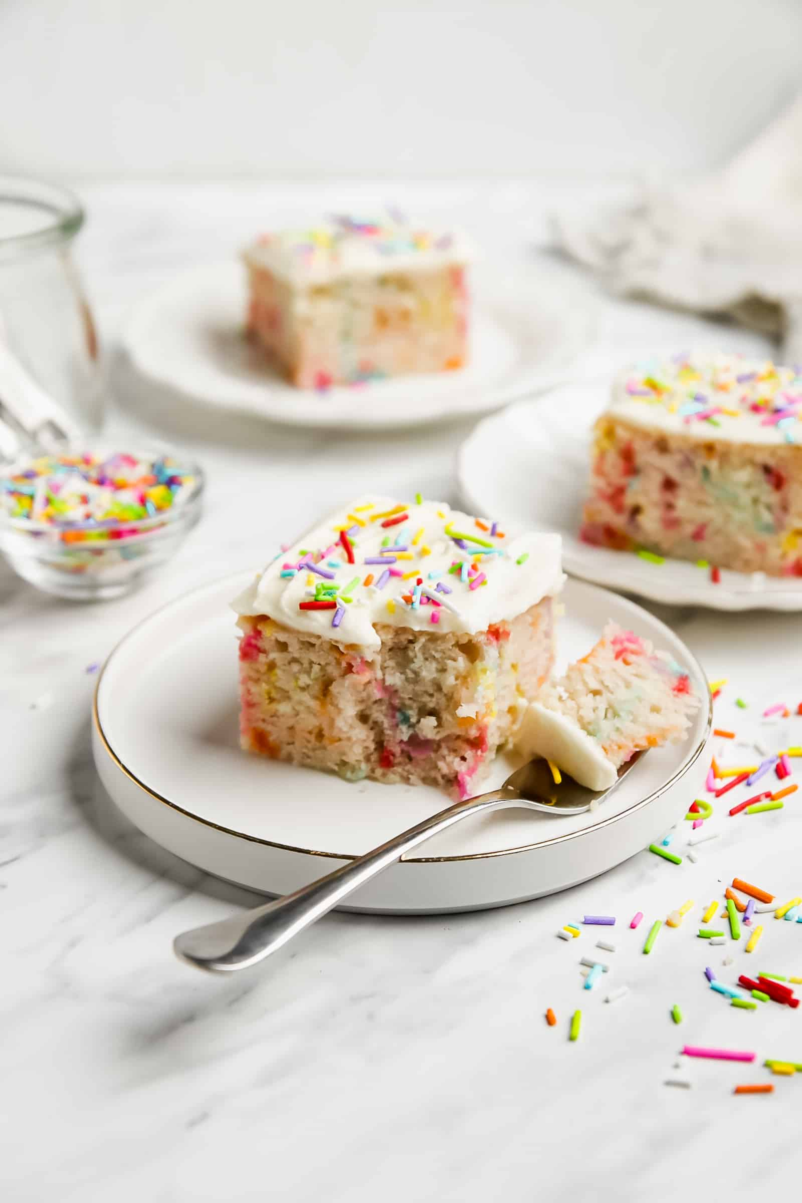 slice of funfetti sheet cake on a plate
