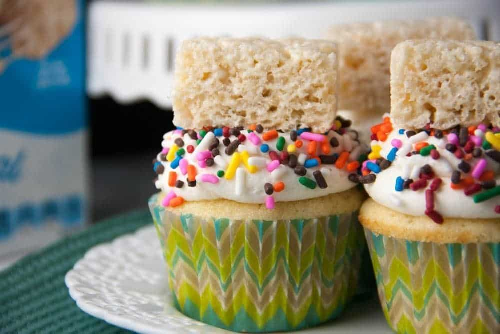 cupcakes topped with a rice krispie treat on a plate