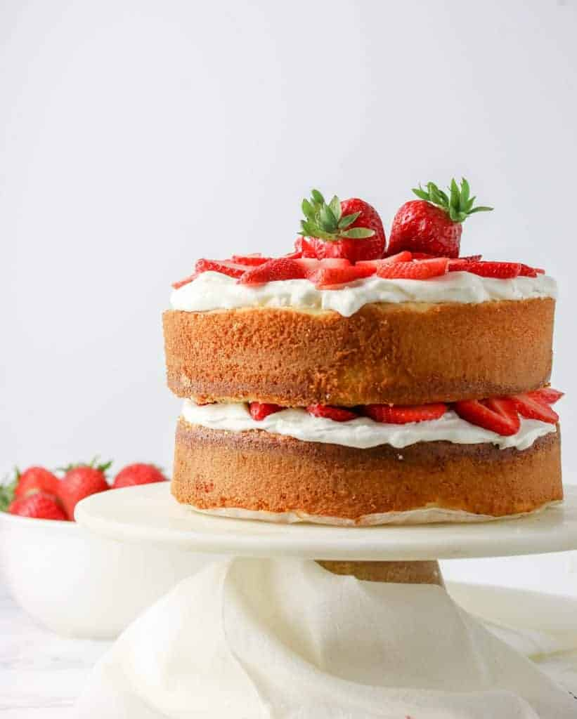 vanilla sponge cake layered with whipped cream and strawberries
