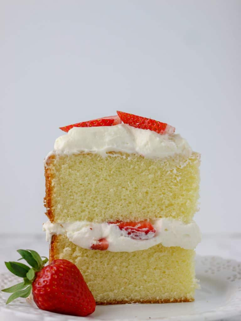 slice of vanilla sponge cake on a plate