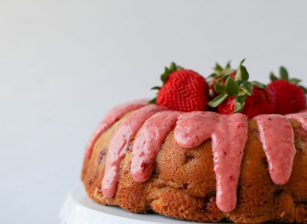 strawberry bundt cake with strawberries piled on top