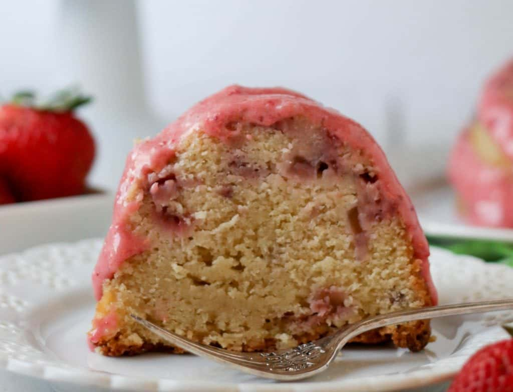 slice of strawberry pound cake on a plate with a fork