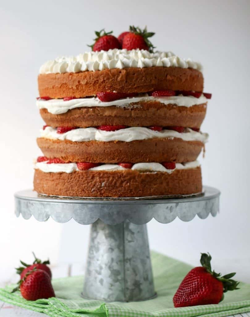 Four Layer Strawberry Sponge Cake on a Metal Cake Stand