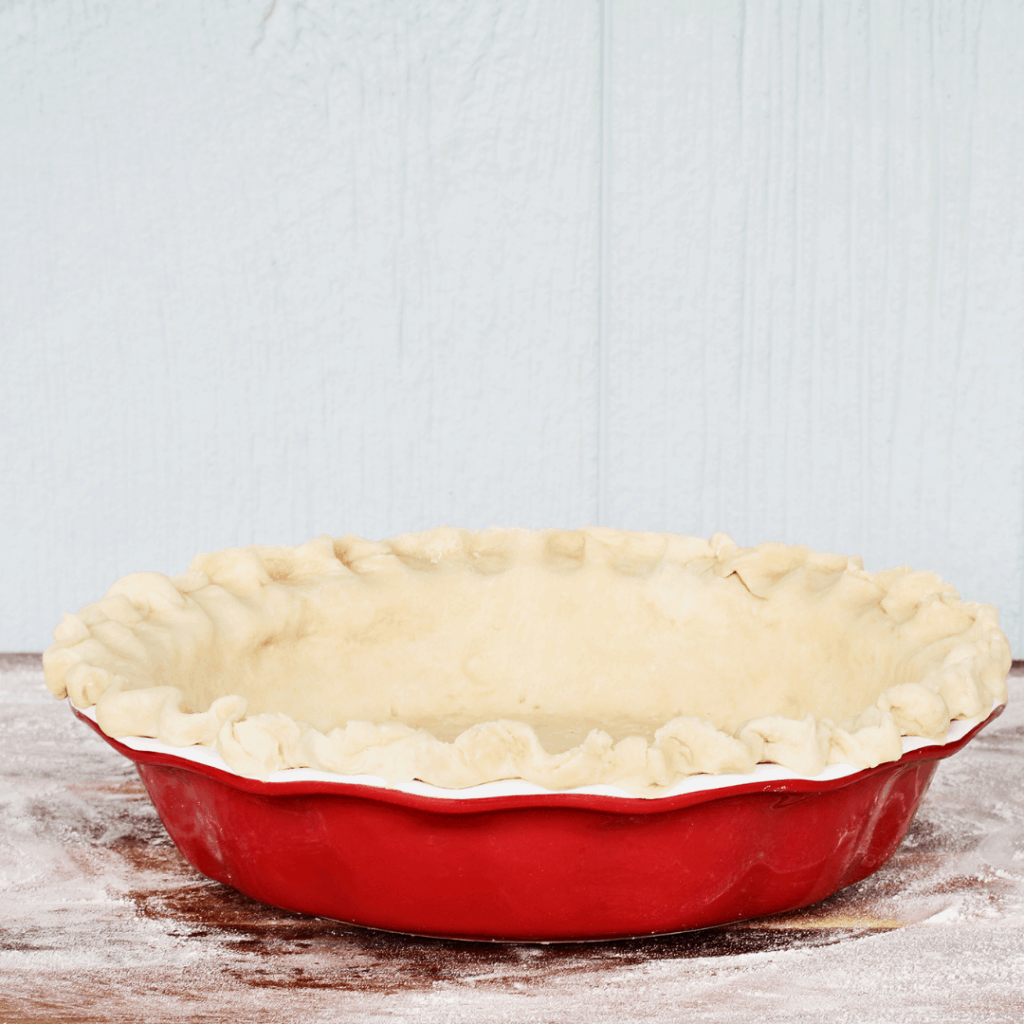 pie pan with unbaked pie crust in it