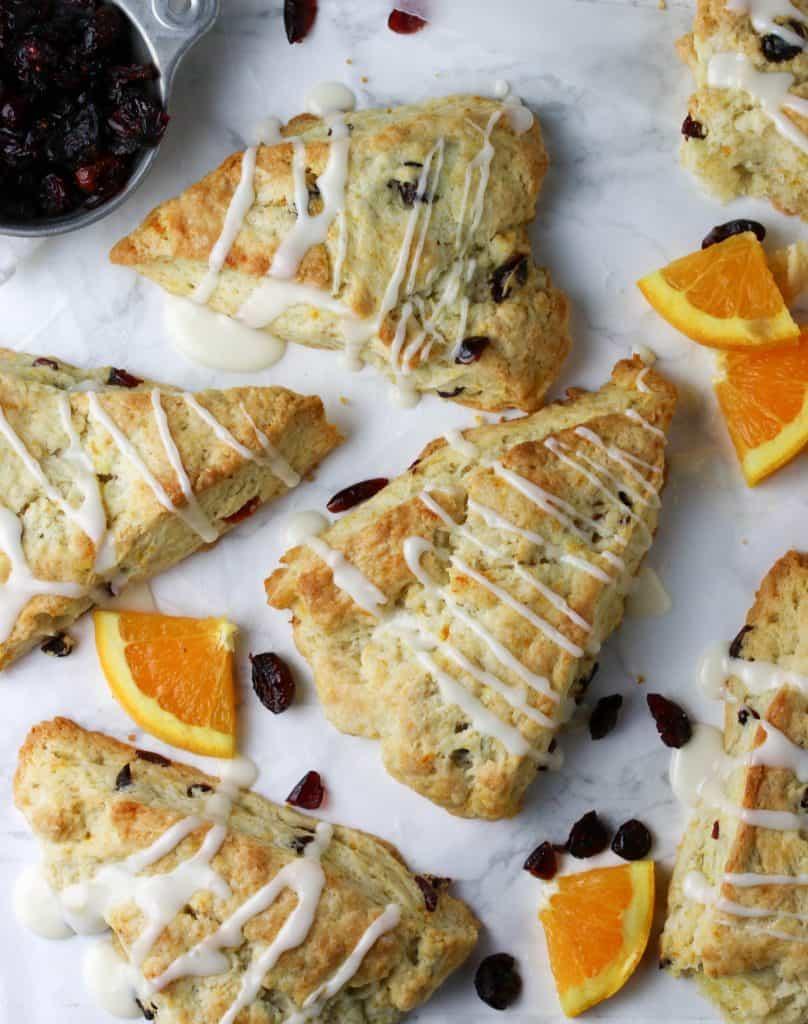 cranberry orange scones on parchment paper