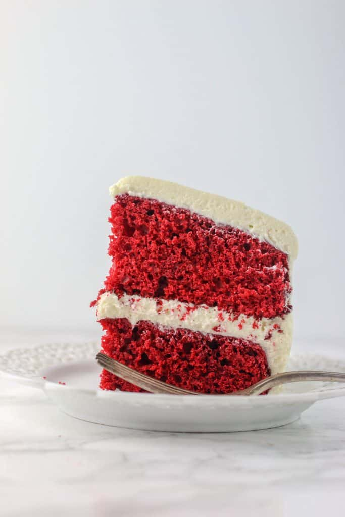 easy red velvet cake recipe slice on a plate with a fork