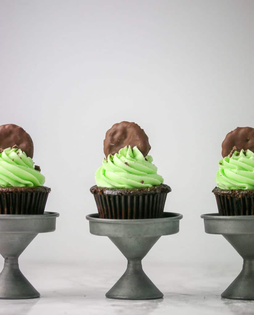 chocolate cupcakes on mini cupcake stands with mint buttercream